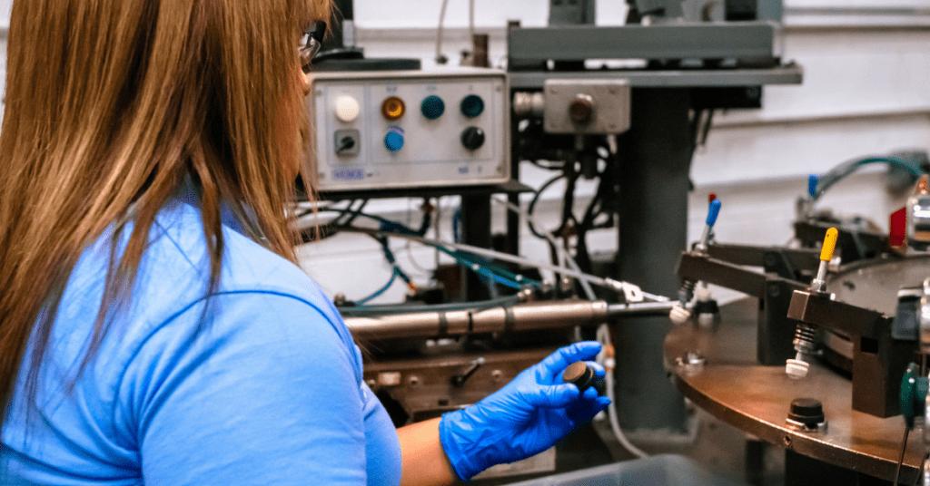 Rogan Corporation Employee assembling product